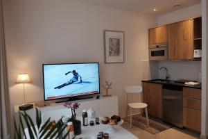 A television and/or entertainment center at Jardin Saint Honoré Apartments