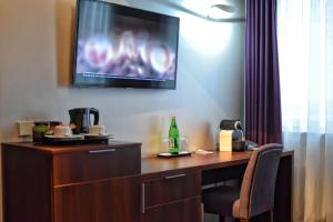 A television and/or entertainment center at Hotel Zamek Centrum