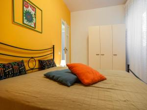 A bed or beds in a room at Casa Zirocco
