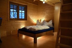 Ένα ή περισσότερα κρεβάτια σε δωμάτιο στο Haus Tabernig