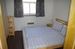 Кровать или кровати в номере Apartment Baťův Domek