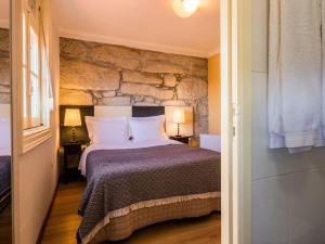 Een bed of bedden in een kamer bij Pedra Iberica