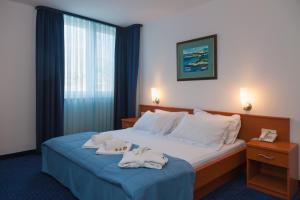 A bed or beds in a room at Hotel Rotondo
