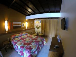 A bed or beds in a room at Atol das Rocas Hotel