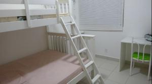 Litera o literas de una habitación en Ajuricaba Suítes 5