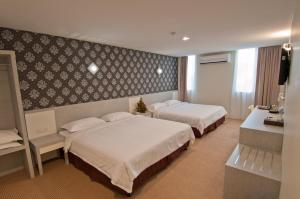 A bed or beds in a room at De Spring Hotel