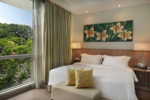Ein Bett oder Betten in einem Zimmer der Unterkunft Hilton Garden Inn Bali Ngurah Rai Airport