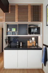 A kitchen or kitchenette at Zoku Amsterdam