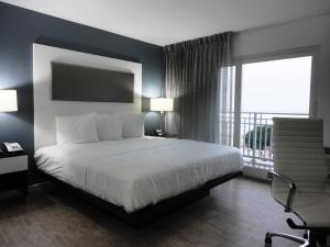 A bed or beds in a room at Lotus Boutique Inn and Suites