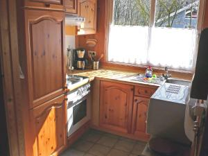 A kitchen or kitchenette at Holiday Home Ferienpark Extertal-2