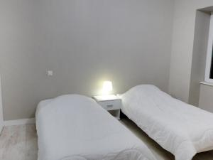 A bed or beds in a room at Apartment Les Cerfs