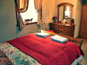 A bed or beds in a room at Apartment Auchenblae