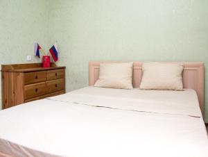 Кровать или кровати в номере ApartLux Профсоюзная