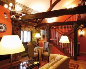 The lounge or bar area at Hotel Rural Casa Xusto