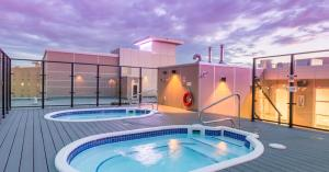 The swimming pool at or near Applause Hotel Calgary Airport by CLIQUE