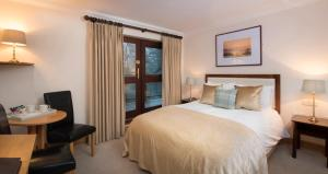 A bed or beds in a room at Delphi Resort Hotel & Spa