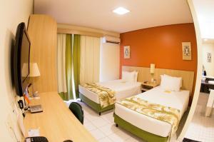 Cama o camas de una habitación en Sleep Inn Manaus