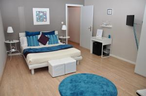 A bed or beds in a room at At Home Bed and Breakfast