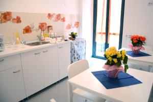 A kitchen or kitchenette at Grigio Pesca