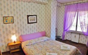 Letto o letti in una camera di Luminous Trastevere Apartment