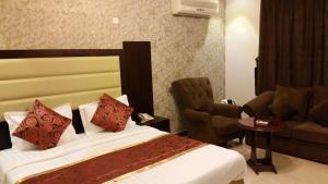 Cama ou camas em um quarto em Mkani Apartment