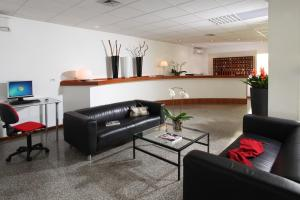 The lobby or reception area at CiampinoHotel