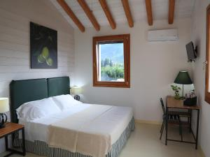 A bed or beds in a room at Luna&Limoni Country