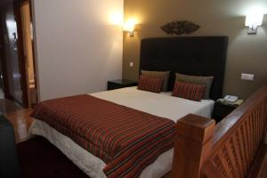 A bed or beds in a room at Hotel Katia