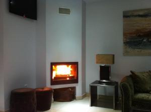 A television and/or entertainment centre at Hotel Katia