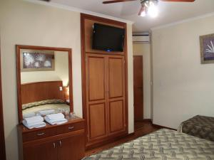 A television and/or entertainment center at Hotel El Cabildo