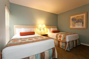 A bed or beds in a room at Star Island Resort and Club - Near Disney