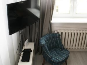 Telewizja i/lub zestaw kina domowego w obiekcie Elektoralna Warsaw Apartment