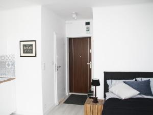 Łóżko lub łóżka w pokoju w obiekcie Elektoralna Warsaw Apartment
