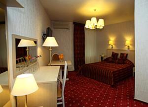 Кровать или кровати в номере Тихая Площадь