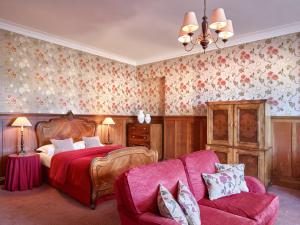 A bed or beds in a room at The Edinburgh Residence