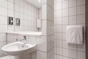 A bathroom at Ramada London Stansted Airport