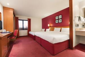A bed or beds in a room at Days Inn Stevenage North