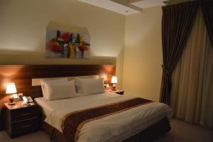 Cama ou camas em um quarto em Myan Furnished Apartments