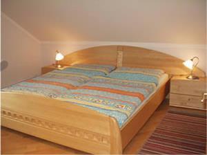 Postel nebo postele na pokoji v ubytování Ferienhaus Anna