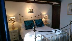 A bed or beds in a room at The Well House