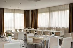 A restaurant or other place to eat at Best Western Plus Tower Hotel Bologna
