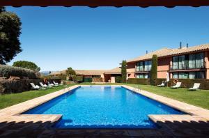 Piscina en o cerca de Torremirona Relais Hotel Golf & Spa