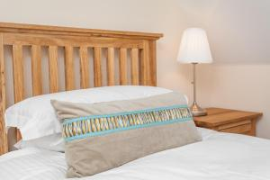 A bed or beds in a room at Watercress Lodges & Campsite