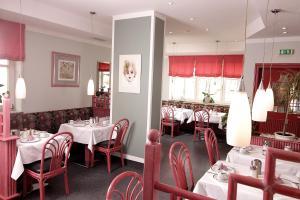 Ein Restaurant oder anderes Speiselokal in der Unterkunft Art-Hotel Erlangen