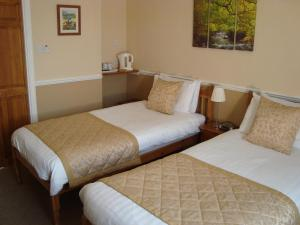 A bed or beds in a room at Willowbank