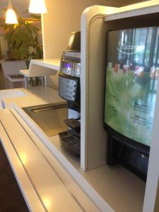A television and/or entertainment centre at Ibis Budget Rambouillet