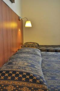 A bed or beds in a room at Hotel Fiorenza