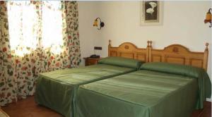 Cama o camas de una habitación en Hostal Las Grullas