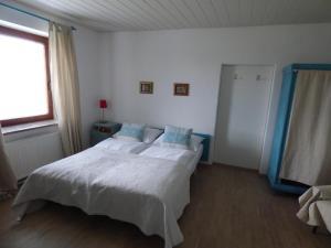 Postelja oz. postelje v sobi nastanitve Apartments Sport Haus Duem