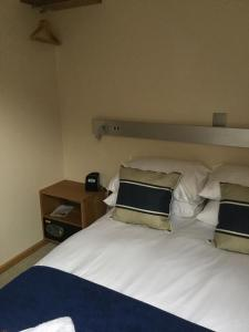 A bed or beds in a room at York Aparthotel